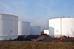 White tanks in tank farm with blue sky Royalty Free Stock Images