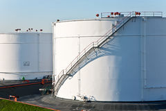 White tanks in tank farm with blue sky Stock Photo