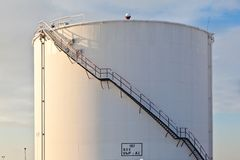 White tanks in tank farm with snow in winter Stock Photo