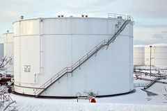 White tanks in tank farm with snow in winter Royalty Free Stock Image