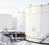 White tanks in tank farm with snow in winter Stock Image