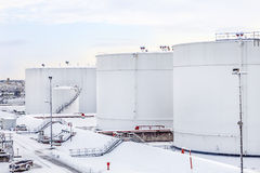 White tanks in tank farm with snow in winter Royalty Free Stock Photo