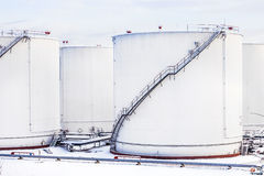 White tanks in tank farm with snow in winter Royalty Free Stock Images