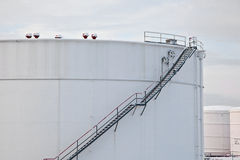 White tanks in tank farm with snow in winter Stock Photos
