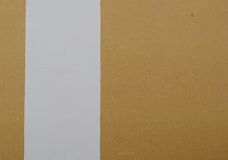 A white tape on cardboard Stock Photography