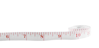 White tape measure on rolled up on white background. White tape measure on rolled up on white isolate background Stock Photos