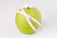 White tape measuring and  apple Royalty Free Stock Images