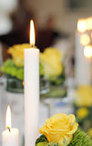 White Candles and Yellow Roses Stock Photos