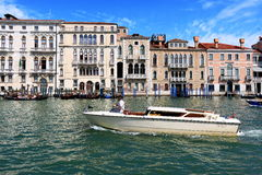 White taxi boat in Grand Canal in Venice, Italy Stock Photos