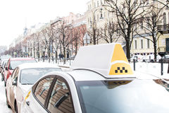 White taxi cab in the city. At winter Royalty Free Stock Photo