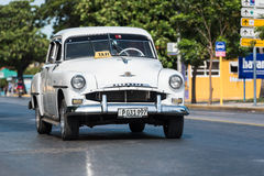 White taxi classic car under way in Cuba Royalty Free Stock Images