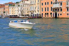 White taxi motor boat in Venice, Italy Royalty Free Stock Images