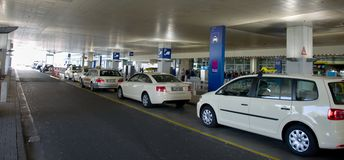 White taxis at the airport of Frankfurt stock photo