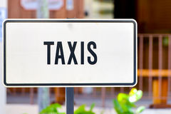 White taxis sign Stock Photo