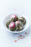 White tea balls with lychee flower Royalty Free Stock Photography
