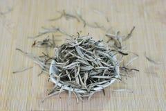 White tea. In bamboo mat stock photos