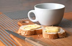 White tea cap with bread and butter Stock Photo