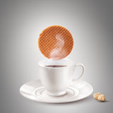 White tea or coffee cup with waffle and sugar Royalty Free Stock Image