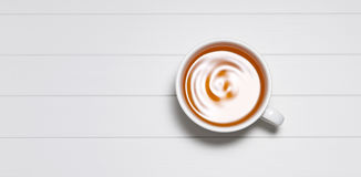 White Tea Cup Background. A cup of tea on a white background photographed from above Royalty Free Stock Photography