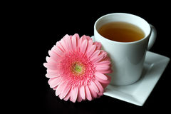 White tea cup with pink flower Royalty Free Stock Photography