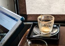 White tea cup and put it beside the window. Is already visible Royalty Free Stock Images