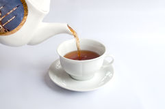White tea cup with red tea stock photo