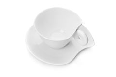 White tea cup and saucer Stock Images