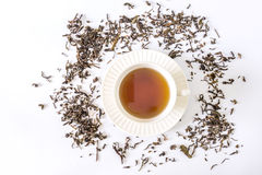White tea cup with tea and tea leaf Stock Image
