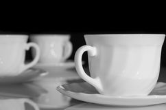 White tea cups. Some white tea cups on a black background Royalty Free Stock Photo