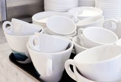White tea cups in a cafe stock photo