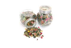 White tea with fruits in storage jar Stock Photo
