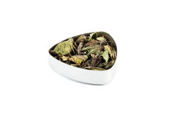 White tea. Indian white tea with vanilla, myrtle and lemongrass, in a metal container Royalty Free Stock Photo