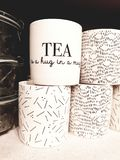 Tea is a hug in a mug. White tea mug with a meaningful text royalty free stock images