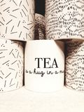 Tea is a hug in a mug. White tea mug with a meaningful text stock images