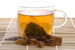 White tea, nylon tea-bag and sugar royalty free stock image