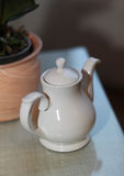 White tea pot on the table Royalty Free Stock Photography