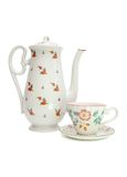 White tea service with rosehips Stock Photo