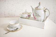 White tea service on white commode ready for use. Start a morning with cup of tea or coffee royalty free stock photo