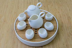 White tea set and bamboo table Royalty Free Stock Image