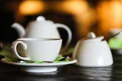 White tea set on the dark wooden table Stock Image