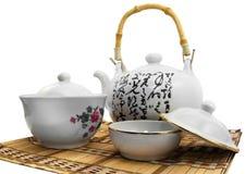 White tea set. Isolated beautiful tea set on wooden surface Stock Photos