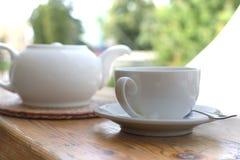 White tea set on outdoor background stock photos