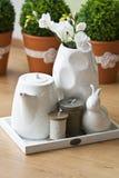 White tea set. Vintage white tea set with ceramic rabbit Stock Images