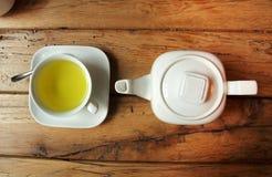 White tea set on wooden table Royalty Free Stock Image