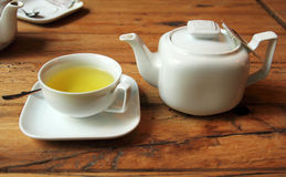 White tea set on wooden table Royalty Free Stock Images
