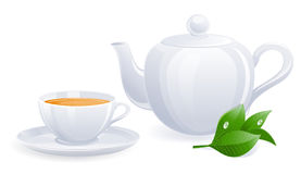 White teacup and teapot with tealeaf Royalty Free Stock Photos