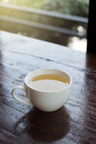 White teacup on wooden table Stock Image