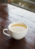 White teacup on wooden table Royalty Free Stock Photo