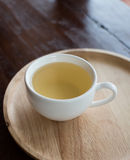 White teacup on wooden table Stock Photo