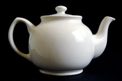 White teapot. On black background Royalty Free Stock Images